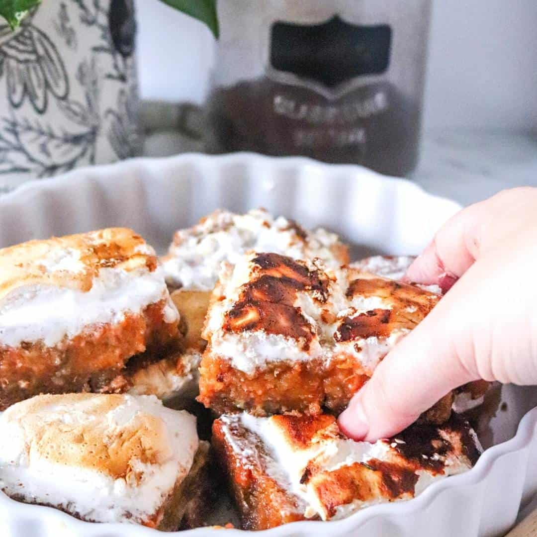 Tasty Sweet Potato Pie Bars, a simple dessert recipe made with sweet potatoes, a graham cracker crust and topped with marshmallows.